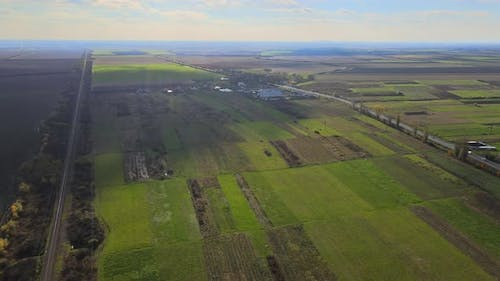 Aerial Top View of a Land with Down Green Fields in Countryside with Grown Plants