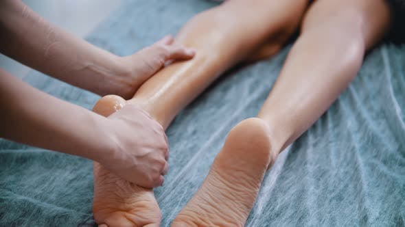 Thumbnail for Massage - Massage Master Massaging Womans Legs and Feet with Oil
