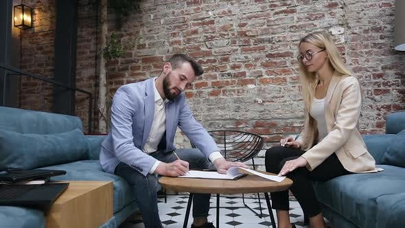 Thumbnail for Two Business People Meet in the Office and Signing an Important Contract