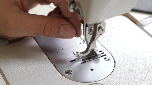 Small Clothes and Bag Manufacture. Process of Inserting Thread Into Needle of Industrial Sewing