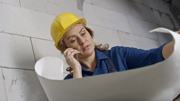 Thumbnail for Female Engineer Talking on Mobile Phone at Work