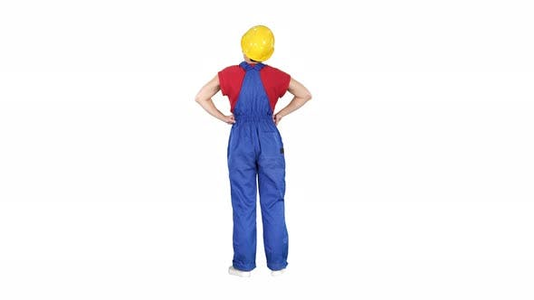 Thumbnail for Woman Engineer in Construction Helmet Stands with Hands on Hips on White Background.