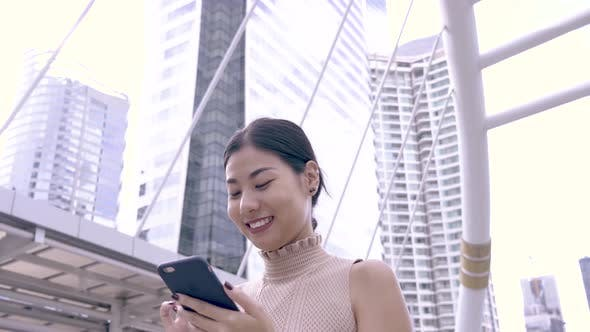 Thumbnail for Asian Woman Chatting On Phone