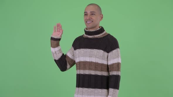 Thumbnail for Handsome Bald Multi Ethnic Man Waving Hand Ready for Winter