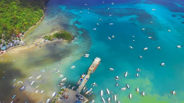 Thumbnail for Boats in the Turquoise Lagoon Near City El Nido, Aerial View. Seascape with Blue Bay and Boats View