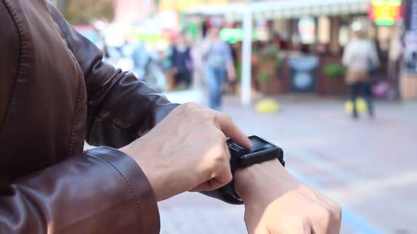 Thumbnail for Girl Using A Smart Watch In The Street During The Day