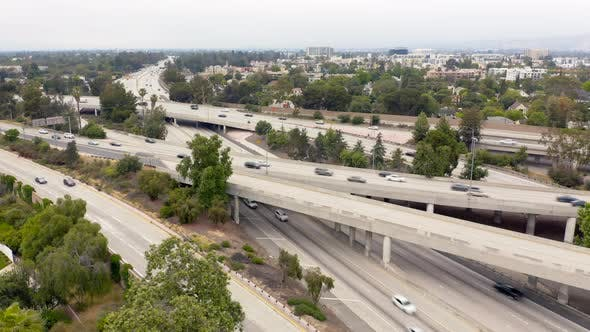 Thumbnail for Los Angeles Freeway. Aerial Shot From the Side. Daytime Traffic in the City