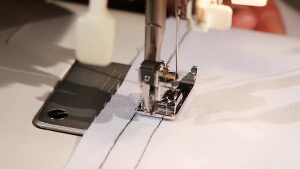 Thumbnail for Sewing Black Thread on White Fabric. Slow Motion