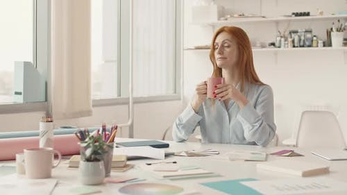Red-Haired Woman Drinking Coffee