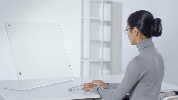 Thumbnail for Asian Woman Working on Invisible Futuristic Computer