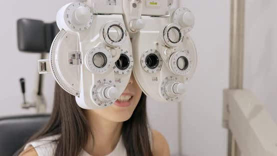 Thumbnail for Woman doing eye test at the clinic