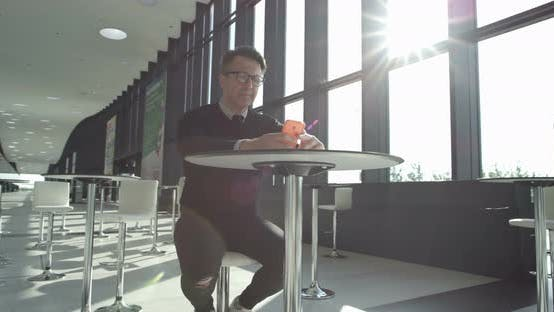 Thumbnail for Man using smartrphone in cafe