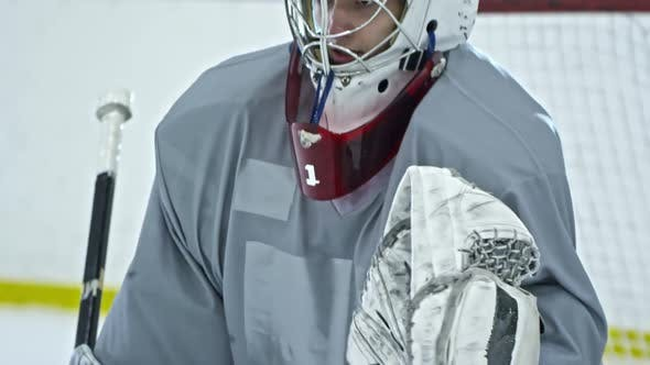 Thumbnail for Hockey Goaltender Catching Puck with Glove