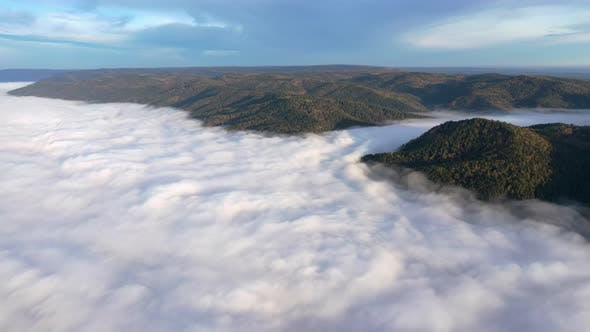 Thumbnail for Aerial Hyperlapse of Fog in a Mountain Gorge at Dawn.