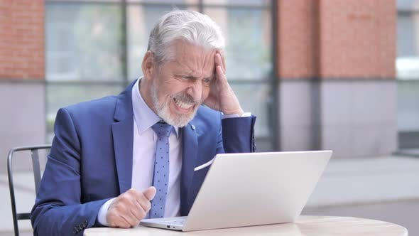 Thumbnail for Upset Old Businessman Reacting to Loss on Laptop Outdoor