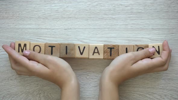 Thumbnail for Motivation, Hands Pushing Word on Wooden Cubes, Positive Thinking Goals, Dreams