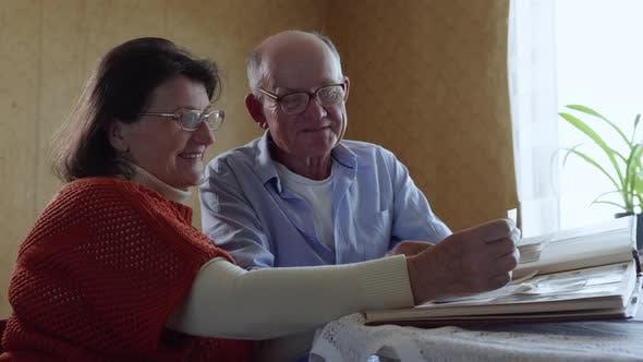 Thumbnail for Happy Memories, a Loving Elderly Husband Enjoys Family Life Kisses His Beloved Cheerful Elderly Wife
