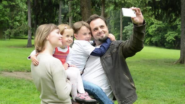 Thumbnail for Family, Middle Couple in Love, Cute Girl and Small Boy, Take a Photo with Smartphone, Selfie, Park