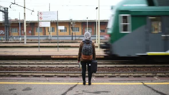 Cover Image for Woman waiting at railroad station platform