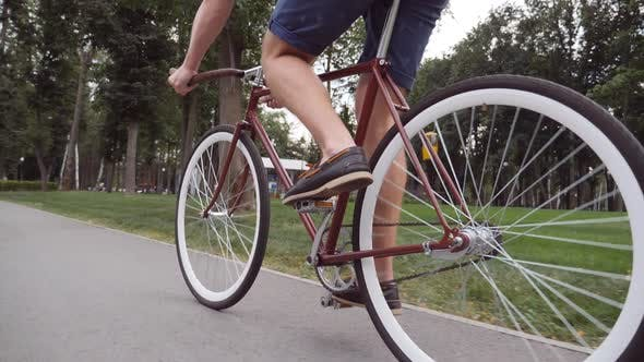 Thumbnail for Unrecognizable Young Man Riding a Vintage Bicycle. Sporty Guy Cycling at the Park. Healthy Active