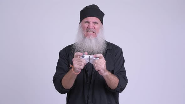 Thumbnail for Stressed Mature Bearded Hipster Man Playing Games and Losing