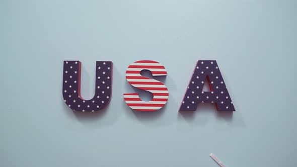 Thumbnail for Painted USA sign with white, red and blue on blue background.