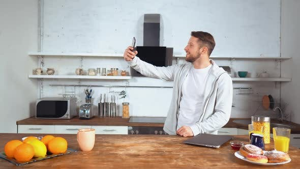 Thumbnail for Man Takes Selfie Photo in His Kitchen