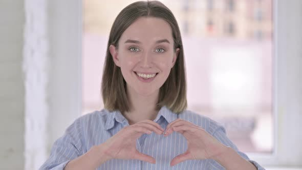 Thumbnail for Portrait of Beautiful Young Woman Making Heart Shape with Hands