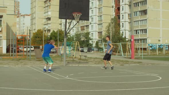 Thumbnail for Two Teenage Friends Practicing Basketball Skills