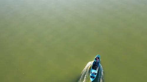 Fishing boat on lake at sunset golyazi