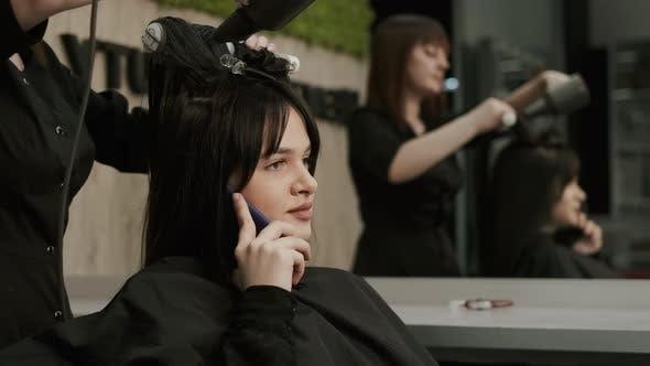 Hair Care In Fashion Studio. Beautiful Young Woman.
