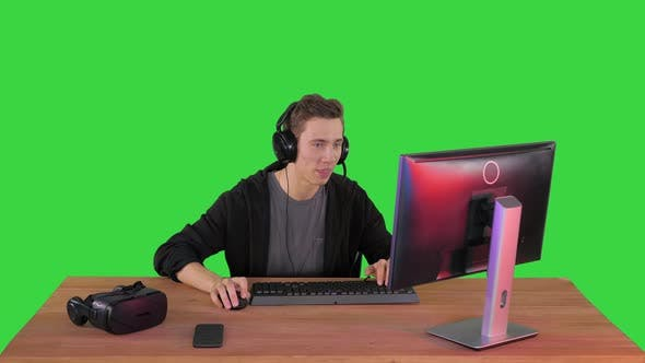 Thumbnail for Professional Gamer Plays Video Game on His Computer and Commenting His Stream on a Green Screen