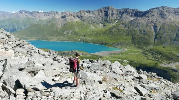 Thumbnail for One person hiking on mountain top, Summer adventures on the Alps