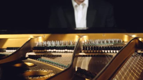 Pianist Playing on a Grand Piano