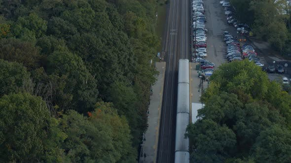 Aerial of railroad tracks and cars parked in town