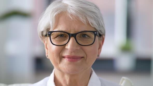 Thumbnail for Portrait of Senior Woman Taking Her Glasses Off