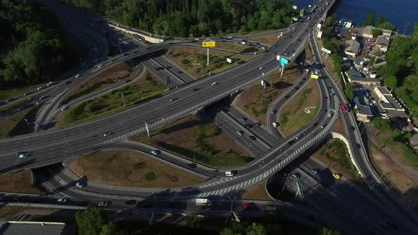 Thumbnail for Highway Intersection on River Landscape, Aerial View Car Driving on Freeway