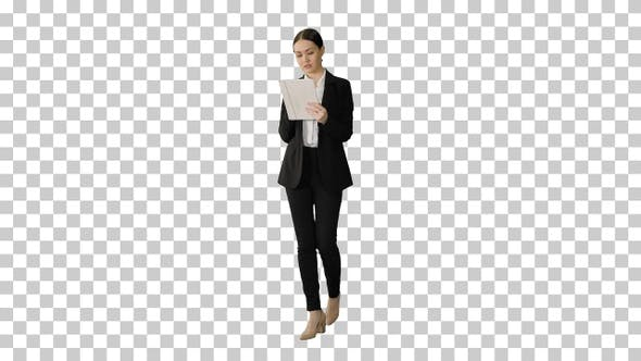 Thumbnail for Businesswoman using a tablet pad while walking, Alpha Channel