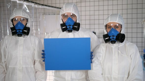 Thumbnail for Lab scientists in safety suits holding empty board.