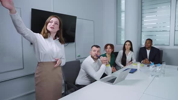 Woman Making Presentation in Office