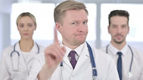 Thumbnail for Portrait of Serious Doctors Saying No By Hand Gesture