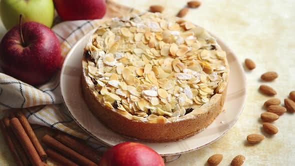 Thumbnail for Freshly Baked Homemade Apple Pie with Almond Flakes Cake on Yellow