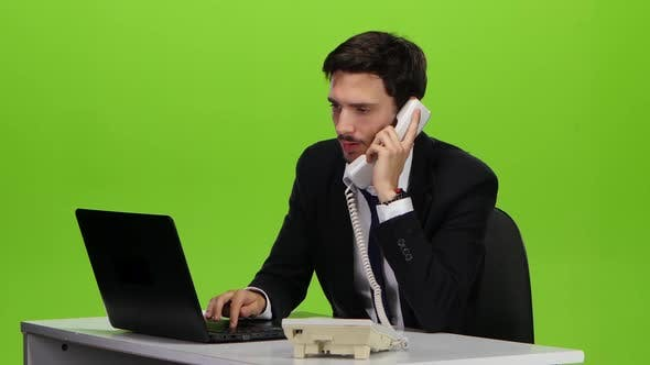 Thumbnail for Businessman Rejoices with the News in a Phone Call Heard