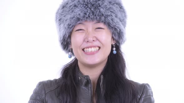Cover Image for Face of Happy Beautiful Asian Woman Nodding Head Yes