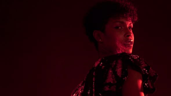 Thumbnail for Woman in Sparkly Dress in Red Light in Nightclub