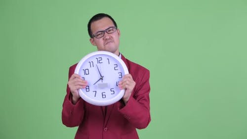 Angry Asian Businessman with Eyeglasses Showing Time