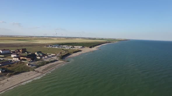 Thumbnail for Wind Farm with Wind Mills in Fields on the Water. Aerial Shot