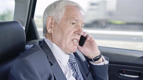 Senior Businessman Talking on Mobile