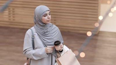 Beautiful Woman in Hijab Talking on Telephone