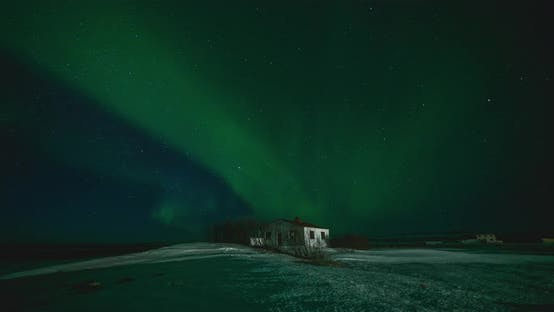 Thumbnail for Timelapse of Aurora Borealis Northern Lights Over Small Building in the Show Field. Iceland